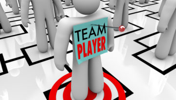 bigstock-a-worker-marked-team-player-is-24835310